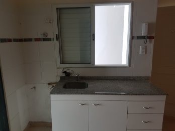 VENDO DEPARTAMENTO 1 DORMITORIO CON PATIO Y COCHERA