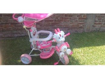 Triciclo color rosa para nena